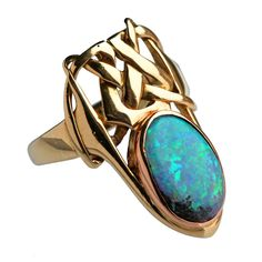 ARCHIBALD KNOX Art Nouveau Ring. An important & previously unrecorded fabulous Liberty & Co Ring designed by Archibald Knox. Gold with a beautiful boulder opal.