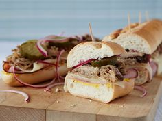 Slow-Cooked Cuban Sandwich : Jeff Mauro cooks boneless pork shoulder in a slow cooker before turning it into a sandwich. When the meat is ready, layer it with Swiss, ham, pickles and onions.