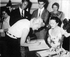 Marilyn signs the guestbook at the White Barn Theatre, Norwalk, Connecticut, 1955.