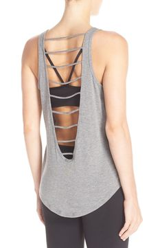 This lightweight workout tank from Zella gets a contemporary update with cool ladder cutouts through the back for a breezy fit.