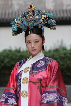 She is a role in The Legend OF ZhenHuan, which is a Chinese history drama. Look at some details, you can get a better picture of the Chinese long history.  By the way, this drama will be acted in American TV channel.