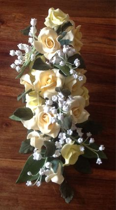 Large cascade of roses & lily if the valley. Hand crafted to order in Artista soft in any colour to complement your wedding theme perfectly. Each if my floral decorations comes with a flower pick to the stem so all youll need to do is pop it into the cake to hold firmly in place for you.