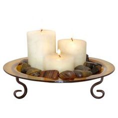 Cast a warm glow over your dining table, console, or mantel with this beautiful design, perfect as an eye-catching centerpiece or imaginative vignette.Product: 1 Tray and 3 candles  Construction Material: Metal and wax Color: Rustic and amberDimensions: 6 H x 11 Diameter (tray) Note: Stones not included