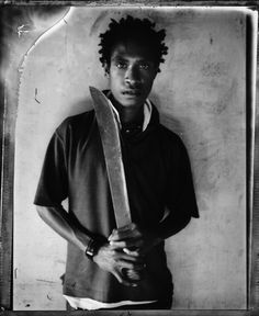 Stephen Dupont's photographs from 'Raskols' are a series of portraits of gang members of the Kips Kaboni (Scar Devils), Papua New Guinea's oldest criminal gang