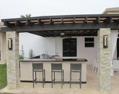 light tile and dark counter on the barbeque wall