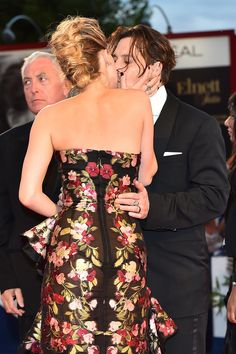 Johnny Depp and Amber Heard Share the Look of Love on the Red Carpet: All eyes were on Johnny Depp and Amber Heard at the Danish Girl premiere at the Venice Film Festival on Saturday.