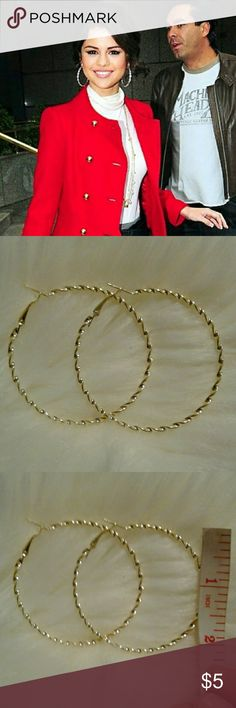 """Selena Gomez Inspired Gold Plated Twist Hoops New in package Gold Plated Won't tarnish- (keep in plastic package for storage) Measures: 2"""" Nickel & Lead Free Perfect Hoops for any occasion boutique  Jewelry Earrings"""