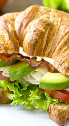 An easy recipe for a Turkey Avocado BLT Croissant Sandwich. Make this delicious Red Robin copycat at home with flaky, buttery croissants, lots of bacon, juicy tomatoes, and as much avocado as you want! Your new favorite lunch. Croissant Sandwich, Soup And Sandwich, Sandwich Recipes, Lunch Recipes, Salad Recipes, Cooking Recipes, Healthy Recipes, Easy Recipes, Subway Sandwich