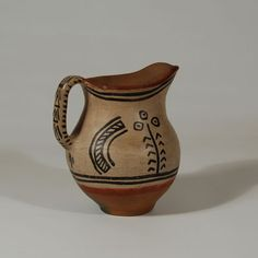 "#adobegallery #TesuquePuebloPottery #TeTsuGehOweengePuebloPottery - Tesuque Pueblo Polychrome Pitcher. Category: #Historic Origin: #TeTsuGehOweengePueblo - #TesuquePueblo Medium: clay, pigment Size: 6""tall x 5 ½"" diameter Item # 25734"