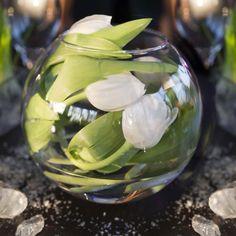 Seasonal wedding flowers in a fishbowl