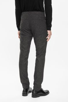 A tapered slim fit, these trousers are made from speckled melange wool that is partially lined in silky fabric. With pockets on the front and back, they have a zip fly fastening, belt loops and a hook fastening on the waistband.