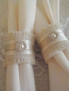 Fun and popular burlap napkin rings are perfect for the holidays including Thanksgiving, Christmas, New Years, Valentines, or even wedding reception or rehearsal dinners! This listing is for a set pf 2 three-inch ivory burlap rings, with 1/2 cream satin ribbon around the center...then topped with golden ribbon and a beautiful pearl and rhinestone embellishment! They are fairly neutral, so will coordinate with most color schemes. Woo your family or your guests with lovely these little bea...