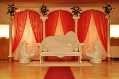 Indian Palace wedding stage by weddingking with crystal sofa, red curtains, crystal curtains en crystal peacocks