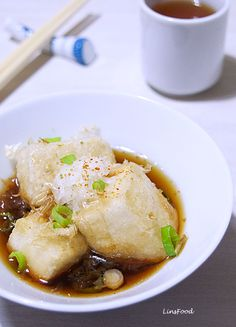 Agedashi Tofu recipe, a Japanese appetiser of crispy on the outside, meltingly soft on the inside, fried tofu sitting in a hot dashi sauce.