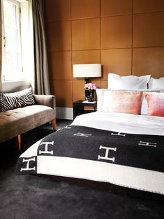 Create a grand yet cozy and modern feel by covering walls in fabric (or, in this case, leather).