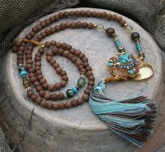 Mala necklace made of 108, 8 to 8,5 mm - 0.315 to 0,334 inch, beautiful Nepalese raktu seed beads and decorated with African turquoise, agate, citrine, two Nepalese beads and a handmade Nepalese ghau (gau) box - look4treasures on Etsy