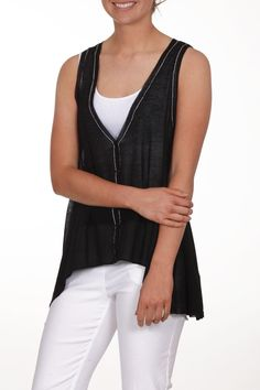 Great black knit vest with buttons going down the front. Has a high low detail and falls at the waist. Will look great with a long sleeve or a short sleeve top and slacks or jeans.  Black Knit Vest by Parkhurst. Clothing - Jackets Coats & Blazers - Vests Iowa