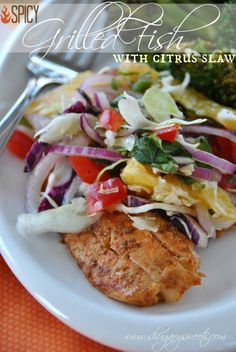 Spicy Grilled Fish with Citrus Slaw6 (4oz) tilapia fillets 1 1/2 tsp chili powder 1 tsp garlic salt 1/2 tsp kosher salt 1 Tbsp ground cumin 1 pinch cayenne pepper 1 lime, juiced 2 Tbsp olive oil For the Slaw: 1 cup thinly sliced green cabbage 1/2 cup thinly sliced red cabbage 1/2 red pepper, 1/2 small red onion, 1/4 cup fresh basil, 2 Tbsp fresh cilantro, 1 jalapeno, 1 large orange, 1 Tbsp olive oil salt black pepper