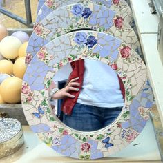 Got broken china? Decorate a mirror with it.