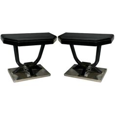 Pair of French 30's Ebonized and Nickel Consoles | From a unique collection of antique and modern console tables at https://www.1stdibs.com/furniture/tables/console-tables/