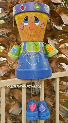 Hi, this is 7 pot size comes to 14 inches tall. This is my second scarecrow i painted. i really enjoy this alot! will be painting some more! whatcha think? Flower Pot Art, Clay Flower Pots, Flower Pot Crafts, Clay Pots, Clay Pot Projects, Clay Pot Crafts, Diy Clay, Flower Pot People, Clay Pot People