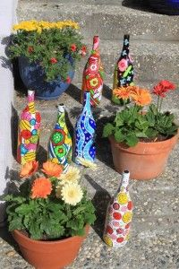 Painted wine bottles - keep filled with water and use to water potted plants. Decorative, fun, and functional.