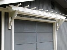 blue roof cabin: DIY Trellis Over the Garage Door