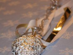Foil and ribbon comets are the perfect activity for reusing discarded ribbon after the holidays.  If your kids are nuts about space like mine is, they will love the idea of making a flying comet.