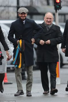 Dapper: The former England captain clutched a pair of leather gloves and a colourful striped scarf as he walked beside his relations