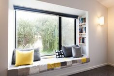 want want want want - window reading nook. look at the book shelves built into the wall!
