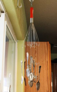 DIY wind chime from a whisk and silverware.  Nice as kitchen decor too