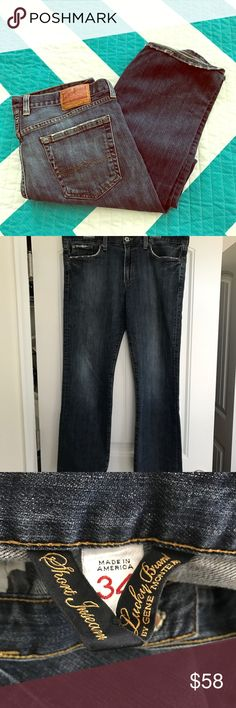 Men's Lucky Brand Dark Wash Light Distressed Jeans Size 34 Lucky brand jeans. These are a darker blue wash with light distressing. Bottoms have minimal fray, brand tag attached inside and out. Inseam measures 31 inches. Back of button appears to have wood glue around it? lol Clean and smoke free! Lucky Brand Jeans Relaxed