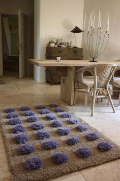 handtufted rugs of wool or linen......handmade in the south of france.....this is LAVANDE....background of linen, lavender bunches of wool and linen....from TapisRectangledOr...on etsy....