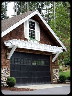 I love everything about this garage.  The door colour, the shingles, the white trim, and the stone.  The window is wear my mom would live.