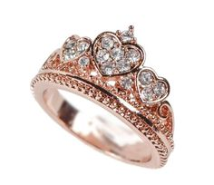 This ring is paved with sparkling white crystal set inside of 3 hearts in a crown/tiara style. The band is lined...