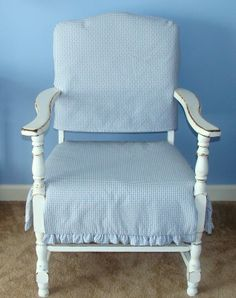 Blue and White Slipcovers on vintage white chair