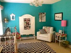 Beautiful turquoise walls set a great backdrop for black & white chevron accents.  #turquoise #chevron #black #nursery