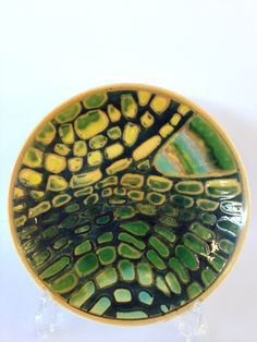 Lot 56 - A Poole Pottery Delphis Studio dish, decorated in an abstract pattern in tones of green and yellow.