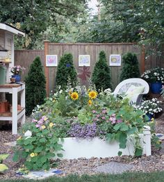 simple raised bed was painted white and then packed with a delightful mix of flowers, vegetables, and herbs. Front House Landscaping, Small Yard Landscaping, Hillside Landscaping, Landscaping Ideas, Backyard Ideas, Garden Ideas, Garden Art, Patio Design, Garden Design