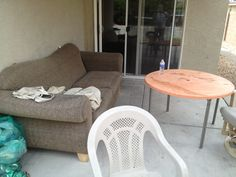 An outdoor patio? Get rid of the indoor furniture, put a table cloth over the table and big potted plant in the corner. Or just remove everything and clean up the space.