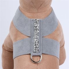 Dress your little rock star up to shine with the Susan Lanci Crystal Rocks Tinkie Harness! This glamorous dog harness shimmers with a strip of rock cut Swarovski crystals for the dog who loves to be center stage noticed and receive extra attention. #DogHarness