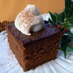 This soft and spicy cake is flavored with molasses, ginger, cinnamon, and cloves. Serve it with fresh whipped cream!