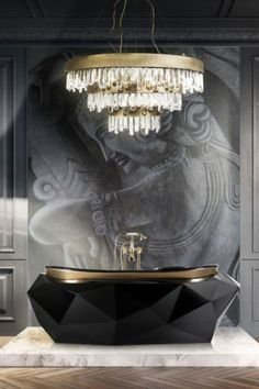On this image: NAICCA Chandelier, IGUAZU Armchair, CAY Side Table by BRABBU, DIAMOND Bathtub, Victorian with Hand Shower Tap by Maison Valentina, and TORCHIERE Floor Light by DelightFULL.  #bathroomdesign #contemporarybathrooms #modernbathrooms #classicbathrooms #mid-centurybathrooms #eclecticbathrooms #luxurybathrooms