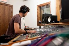 Stock Photo : Young recording engineer at work