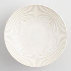 Bring a casual cafe vibe to your table setting with our stoneware bowl. In a textured design, this off-white bowl is beautiful on its own or mixed with other dinnerware for an eclectic flair.