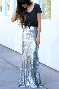 As Seen On Jessa of @jessakae! Take a trip to the moon and dance among the stars with the Kickin' Up Stardust Silver Sequin Maxi Skirt! Woven poly is decorated with a sea of sparkling silver sequins that bedazzle from the high fitted waist, down to the flaring maxi hem. Hidden zipper/hook clasp at back. Fully lined. 100% Polyester. Dry Clean Only.