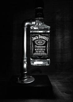 Desk Lamp - Table Lamp - Steampunk Desk Lamp - Industrial Desk Lamp - Steampunk Table Lamp - Bedside Light - pipe lamp - Jacks Barlight Jack's Barlight's main feature is its 70cl Jack Daniels whiskey bottle. Light illuminates the text of the bottle's label creating a gorgeous effect. The bottle is not cut open from the bottom but is left whole and the bottle can be easily unscrewed for access to the bulb. This lamp comes with a dimmable rotary switch with a gold colour knob and a dimmabl...