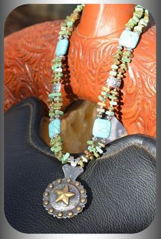 "Western Cowgirl Star Concho Necklace Turquoise Beads Adjustable from 14 1/2"" to 17"" cowgirl star concho necklace with turquoise howlite beads & silver accents.  Concho measures 1 1/2"".    HANDCRAFTED by me & is one-of-a-kind.You can also visit me on FaceBook at Bandana Janna's Gemstone Jewelry & Accessories"