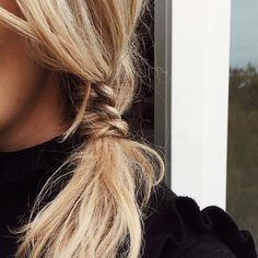 This braid and low pony tail hybrid is a cute and easy hairstyle for long hair