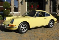 1969 porsche 912 yellow - 3rd car. I drove this until 5 months pregnant with second child.